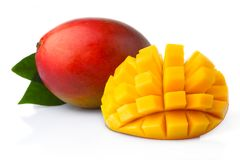 Ripe mango fruits with slices isolated on white Royalty Free Stock Photography
