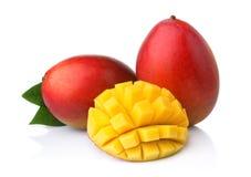 Ripe mango fruits with slices isolated on white Royalty Free Stock Photo