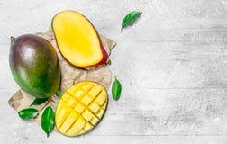 Ripe mango on paper stock image