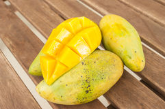 Ripe mango in a pile of mango. In wood table Stock Images