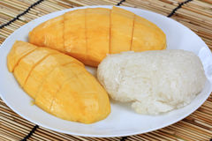 Ripe mango and sticky rice cooked with coconut milk Stock Photos