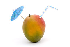 Ripe mango with straw and umbrella Royalty Free Stock Image