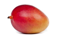 Ripe Mango. Whole ripe and juicy mango on white background Royalty Free Stock Photos