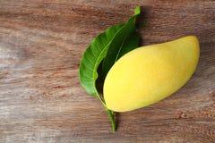 Ripe mango on wood background. Stock Photos