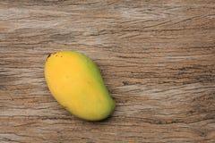 ripe mango on the wooden board. Background:  ripe mango on the wooden table Royalty Free Stock Photo