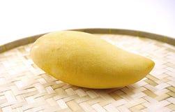Ripe mango on woven basket isolated Stock Photo