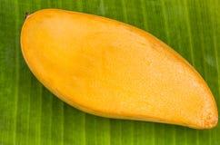 Ripe mangoes. On banana leaf  stock photo Royalty Free Stock Photos