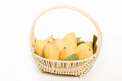 Ripe mangoes in basket Stock Photo