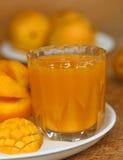 Ripe mangoes with juice Stock Image