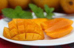 Ripe mangoes with mint leaves Royalty Free Stock Photo