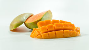 Ripe mangoes in white background/Fresh Sliced cubes. royalty free stock images
