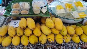 Ripe mangos and sticky rice in coconut milk  with price tag for sell Royalty Free Stock Images