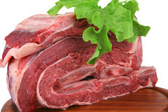 Ripe meat heap. Fresh uncooked meat heap on wood tray Stock Photo