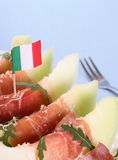 Ripe melon with ham, parmesan with Italy flag Stock Photography
