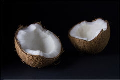 Ripe and mouth-watering coconut. Isolated on a black background Royalty Free Stock Photo