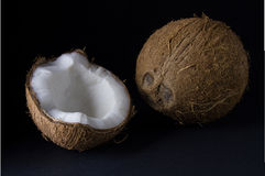 Ripe and mouth-watering coconut. Isolated on a black background Stock Photo