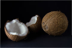 Ripe and mouth-watering coconut. Isolated on a black background Royalty Free Stock Image
