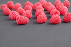 Ripe natural raspberries on dark background. Close-up view. Copy space for text Royalty Free Stock Photo