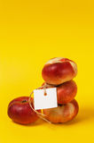 Ripe nectarine with label on the yellow Stock Photo