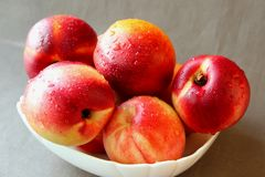 Ripe nectarines in a bowl Stock Photo