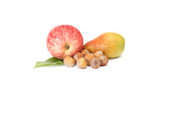 Ripe nuts,pear and apple on a white. Royalty Free Stock Photo