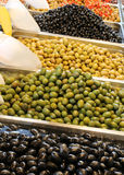 Ripe olives of many qualities for sale on sale in the mediterran. Trays of ripe olives of many qualities for sale on sale in the mediterranean market Stock Photos