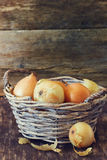 Ripe onion in a vintage basket Royalty Free Stock Image