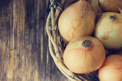 Ripe onion in a vintage basket Stock Image