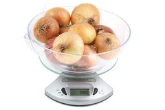 Ripe onion weighing electronic scales Stock Photo
