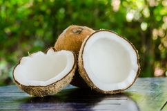 Ripe and open coconuts. On the table Stock Photography