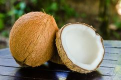 Ripe and open coconuts. On the table Royalty Free Stock Images