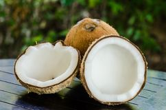 Ripe and open coconuts. On the table Stock Photos