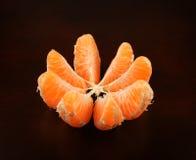 Ripe orange on black Stock Photo