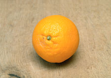 Ripe orange on brown wooden surface closeup Stock Photography