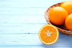 Ripe orange fruit on a blue background stock photos