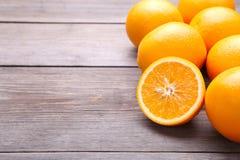 Ripe orange fruit on a grey background royalty free stock image