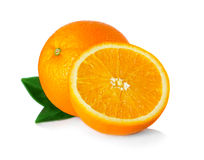 Ripe orange fruit with leaves and slices isolated on white Royalty Free Stock Images