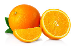 Ripe orange fruit with leaves and slices isolated on white Stock Photo