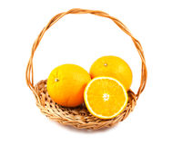 Ripe orange fruits in a wicker basket Royalty Free Stock Images