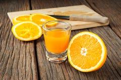 Ripe orange. And orange juice on wooden table stock photography