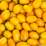 Ripe orange kumquat Stock Images