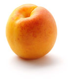 Ripe orange peach. On a white background Royalty Free Stock Photo