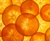 Ripe orange persimmon fruit slices as food background royalty free stock images