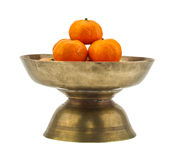 Ripe orange placed on brass tray with pedestal Royalty Free Stock Photography