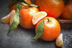 Tangerine fruit. Ripe orange tangerine clove on the gray table Royalty Free Stock Images