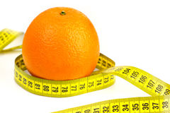 Ripe orange and tape measure Stock Image