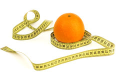 Ripe orange and tape measure. Bright ripe orange and tape measure on a white background Royalty Free Stock Photography