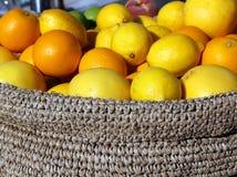 Ripe Orange and yellow Sicilian lemons in a box Royalty Free Stock Image
