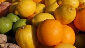 Ripe Orange and yellow Sicilian lemons and green lime Stock Photo