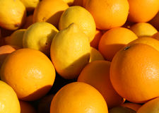 Ripe Orange and yellow Sicilian lemons for sale in greengrocers Stock Image
